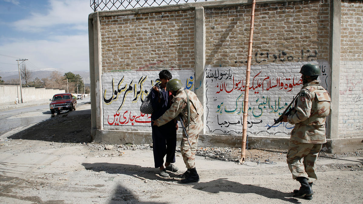 File image of Pakistani Paramilitary soldiers searching a man from the Hazara community  in Quetta after Lashkar-e-Jhangvi's  sectarian attack on Shias which killed 80 people in Quetta on February 16, 2013. (Photo: Reuters)