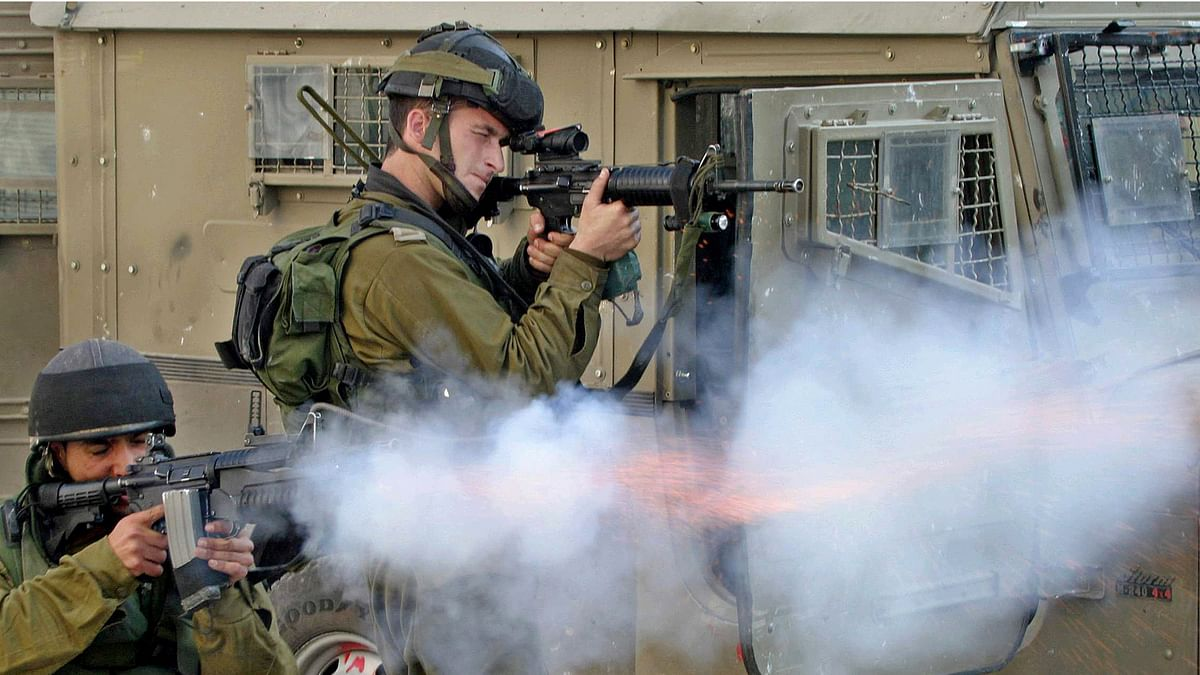In this file photo Israeli soldiers are seen firing at Palestinian youth during clashes in the West bank city of Hebrom. (Photo: Reuters)