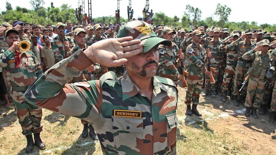 Indian army soldiers pay tribute to their colleague Randeep Singh who was killed in  rebel attack in Manipur. (Photo: AP)