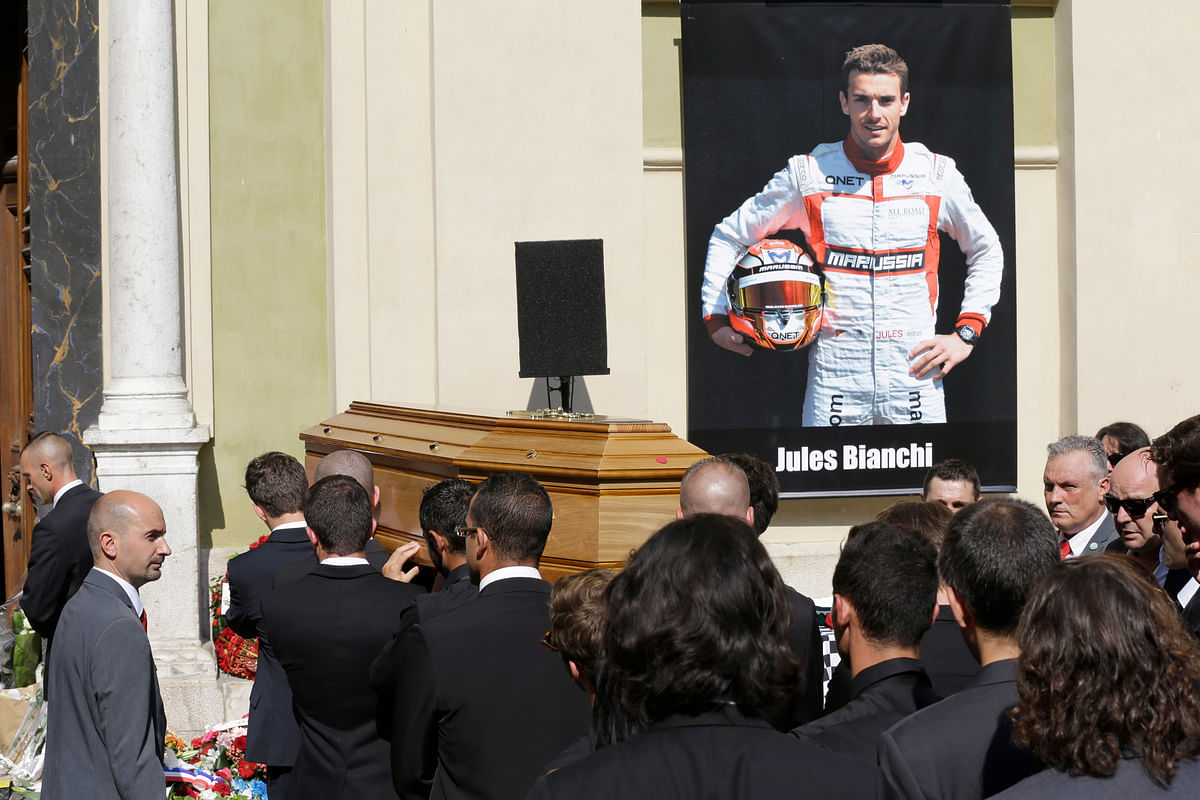 Pallbearers carry the casket of French Formula One driver Jules Bianchi into Sainte Reparate Cathedral during his funeral in Nice. (Photo: AP)