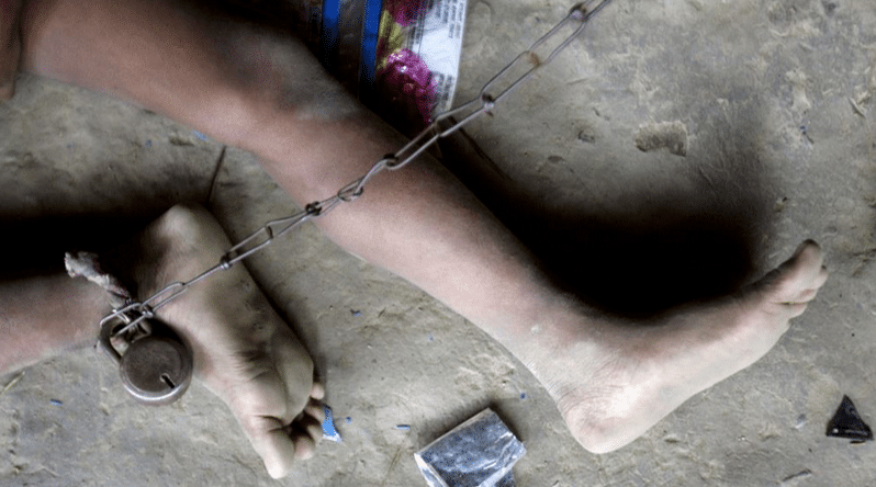 2014 Siliguri: 8-year-old Shomvu Sharkar is chained inside his hut. Shomvu is mentally ill and gets epileptic seizures multiple times a day (Photo: Reuters)