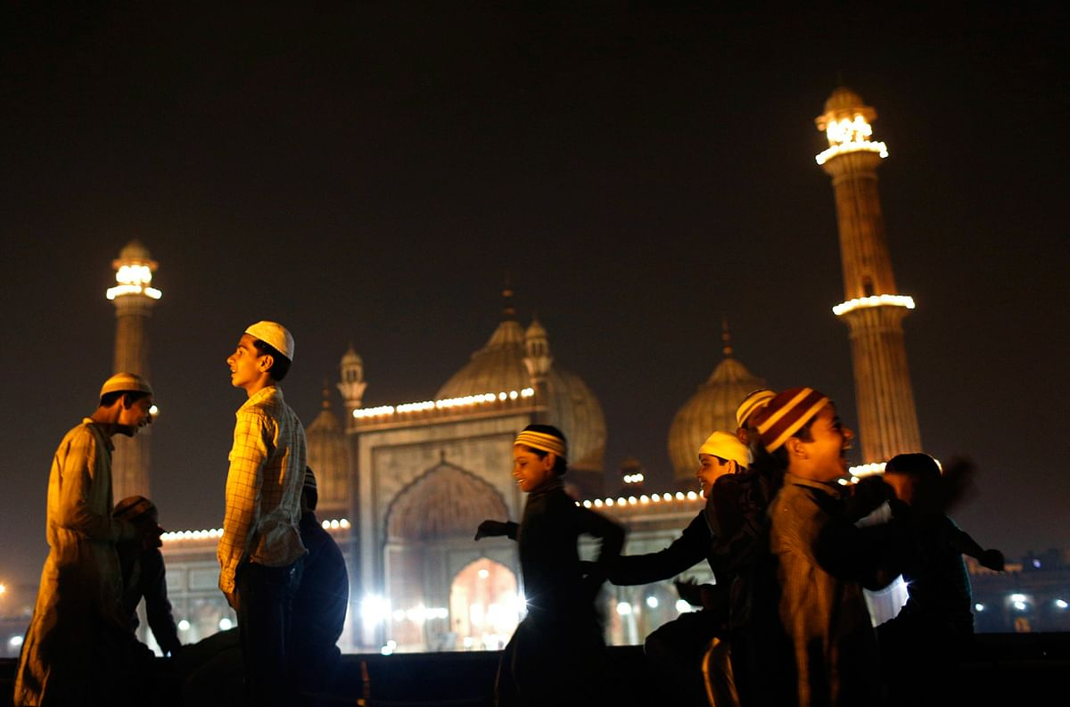 Muslim children celebrate after Eid ul-Fitr was announced at the illuminated Jama Masjid (Grand Mosque) in the old quarters of Delhi August 8, 2013. The Eid ul-Fitr festival marks the end of the holy month of Ramadan. (Photo: Reuters)