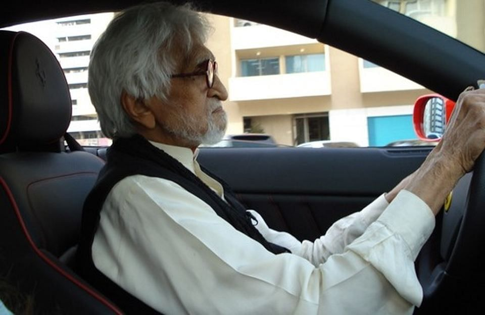 MF Husain driving his Ferrari.