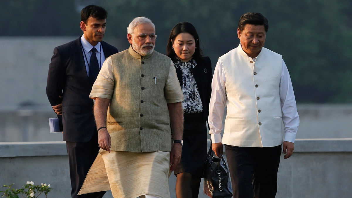 India needs to act cautiously on the AIIB initiative as China has been accused of economic coercion in the past. China's President Xi Jinping with PM Modi in Ahmedabad, September, 2014 (Courtesy: Reuters)