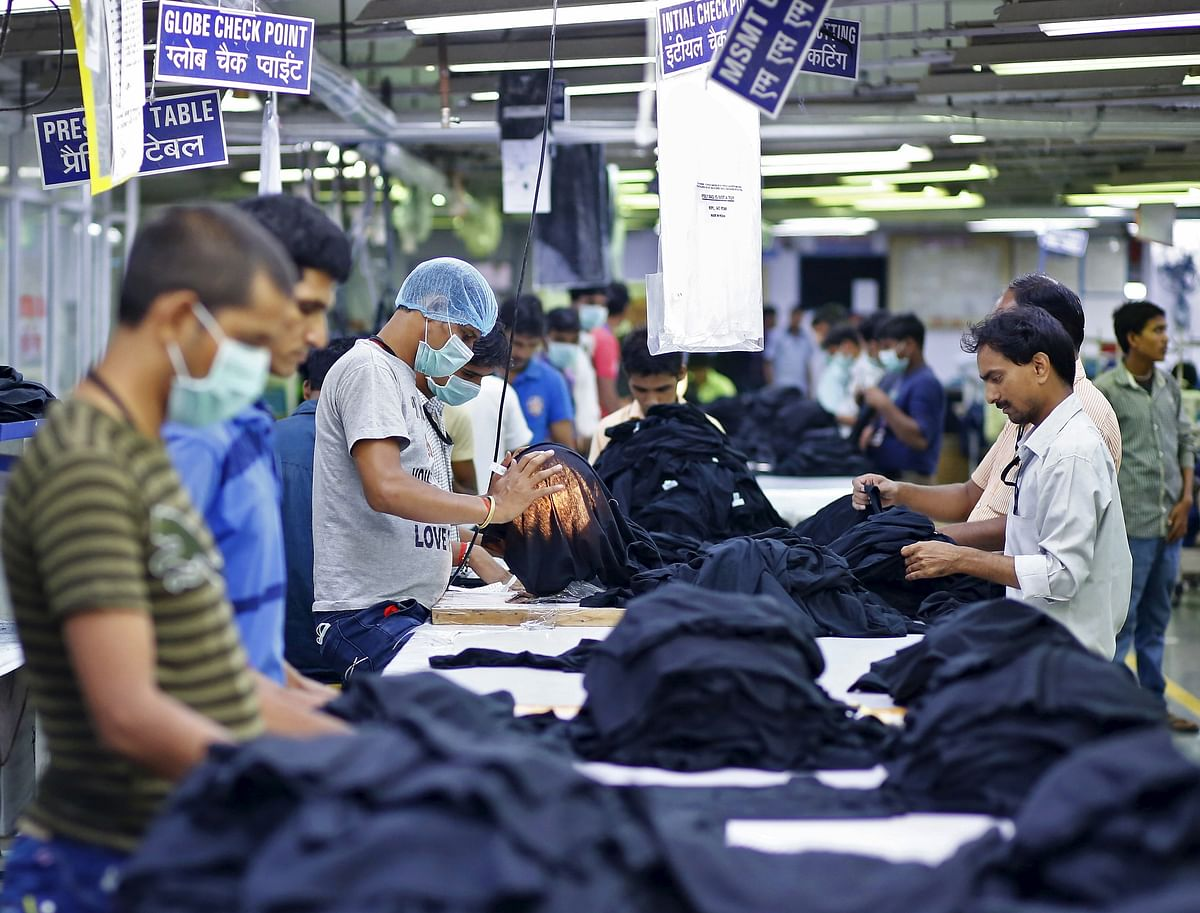 Employees work inside a garment factory of Orient Craft Ltd. (Photo: Reuters)