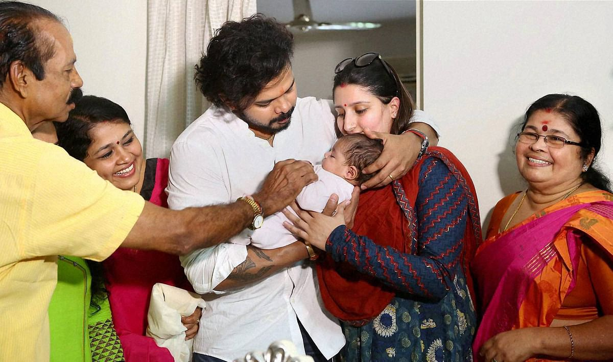Kochi: Cricketer S Sreesanth celebrate with his family, after beingdischarged by a Delhi's court in IPL scam, at his residence in Kochi on Sunday. (Photo: PTI)