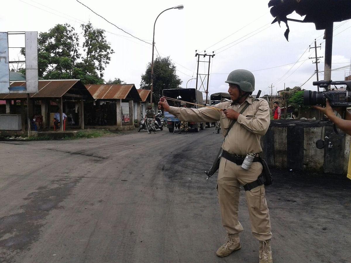 A policeman uses a catapult in Imphal. (Photo: Sunzu Bachaspatimayum)