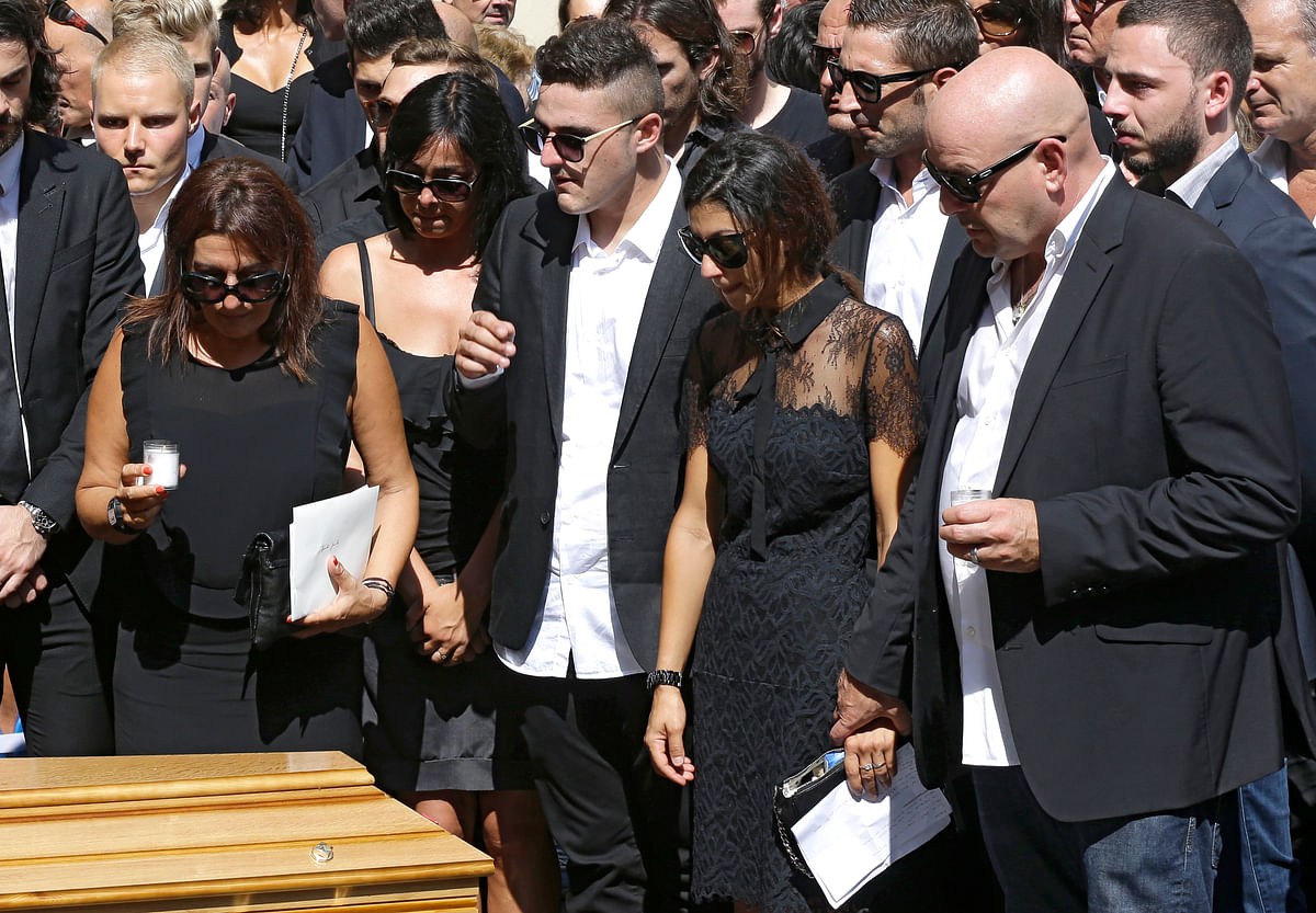 Parents and familyof French Formula One driver Jules Bianchi stand near his casket at Sainte Reparate Cathedral during his funeral in Nice, French Riviera. (Photo: AP)