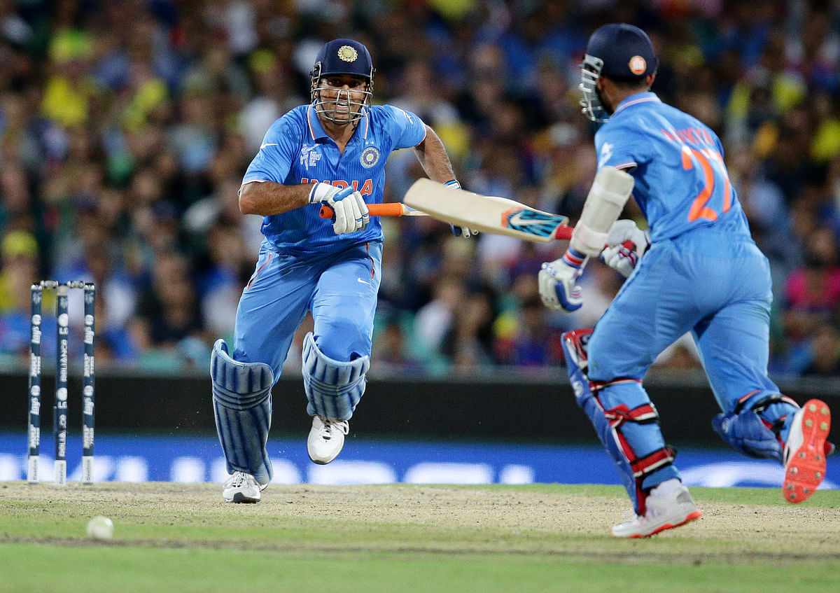 India's MS Dhoni, left, runs down the wicket with teammate India's Ajinkya Rahane while batting against Australia during the World Cup semifinal. (Photo: AP)