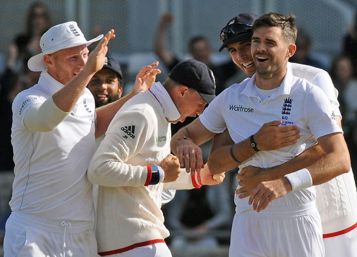 England's James Anderson celebrates with teammatesafter bowling Australia's David Warner for 77 runs during the third Ashes Test. (Photo: AP)