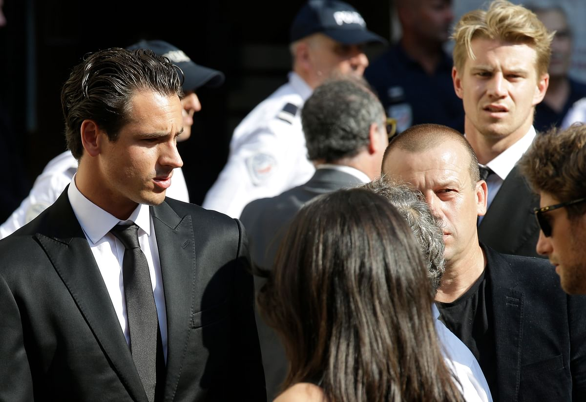 German Formula One drivers Adrian Sutil, left and Nico Hulkenberg, right behind, at the service. (Photo: AP)