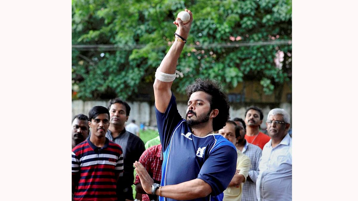 Kochi: Fans look on as cricketer S Sreesanth returns to practice after being discharged by a Delhi court in IPL scam. (Photo: PTI)