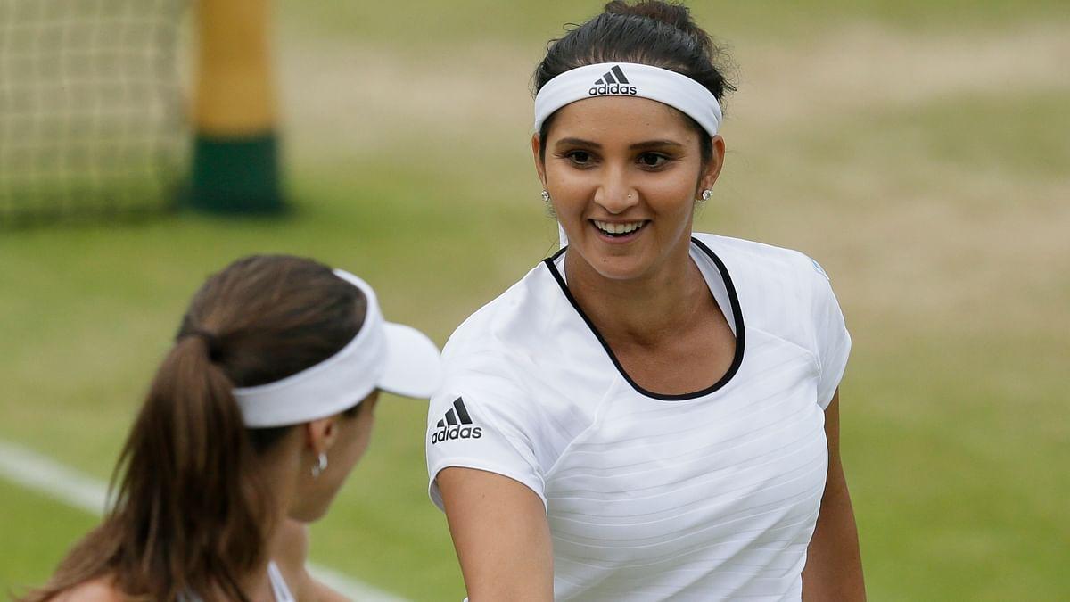 Martina Hingis and Sania Mirza  will play the women's doubles final on Saturday night at Wimbledon. (Photo: AP)