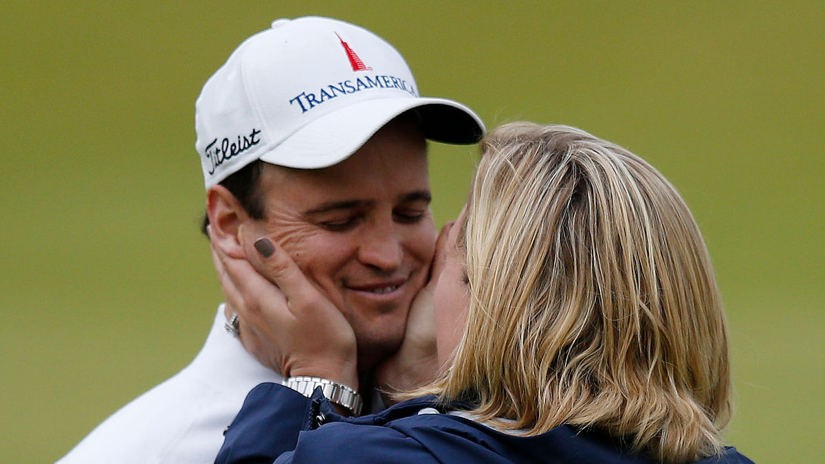 Zach Johnson hugs his wife Kim Barclay after winning the British Open on Monday. (Photo: Reuters)