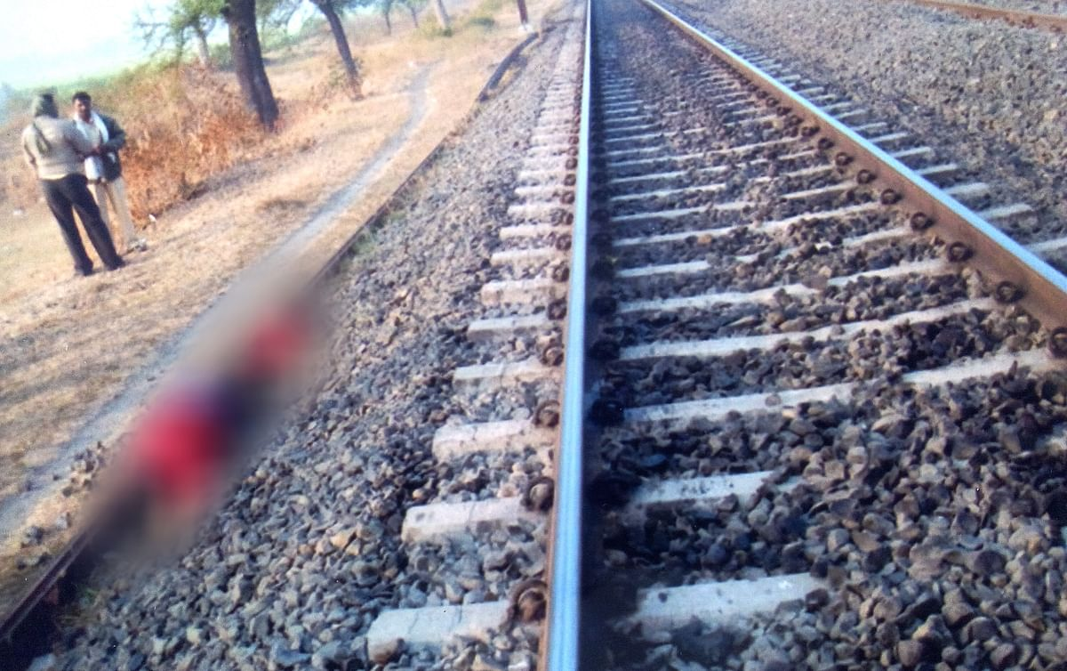 Crime scene photo showing Namrata's body next to the tracks.