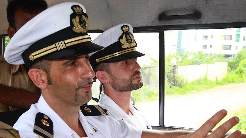 Italian sailors Massimiliano Latorre (left) and Salvatore Girone in a police vehicle after they appeared in a Kochi Court. (Photo: Reuters)