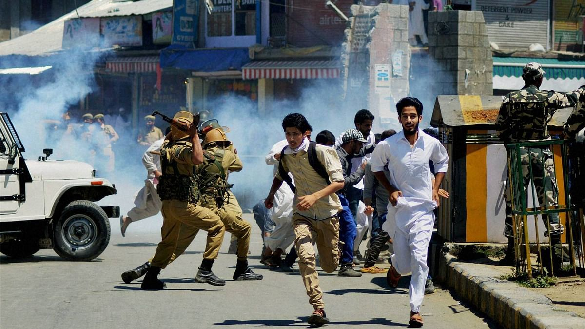 Jammu and Kashmir police and security forces during clashes with protesters in Anantnag on Friday. (Photo: PTI)