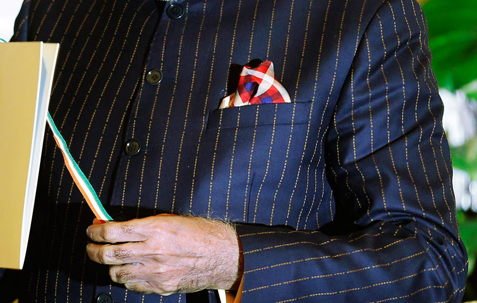 "A close-up view of Prime Minister Narenda Modi's dark pinstripe suit, repeatedly embroidered with the words ""Narendra Damodardas Modi"". (Photo: Reuters)"