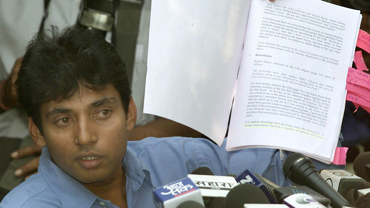 In this photo of 2000, Indian cricket star Ajay Jadeja shows his statement after being named in a match-fixing report along with former captain Mohammad Azharuddin. (Photo: Reuters)