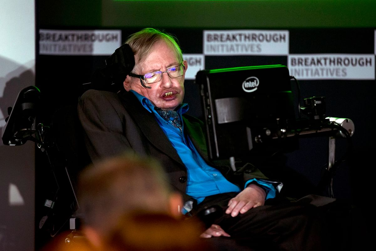 Renowned physicist Stephen Hawking sits in front of a presentation image during a press conference in London. (Photo: AP)