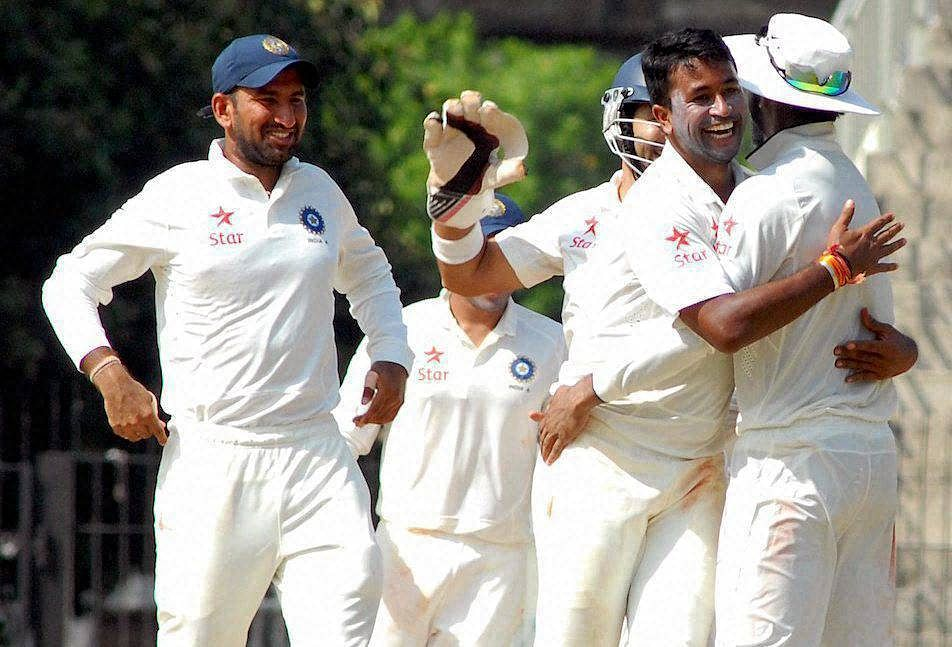 Pragyan Ojha of India A celebrates the dismissal of TM Head of Australia 'A' during the 4-day match in Chennai on Thursday.(Photo: PTI)