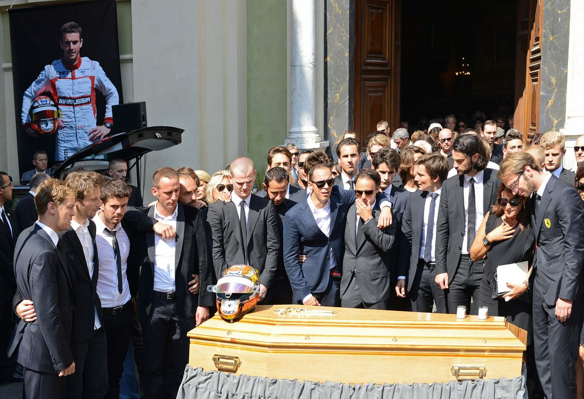 Friends and Formula One drivers gather around the coffin of late Marussia F1 driver Jules Bianchi during the funeral ceremony. (Photo: Reuters)