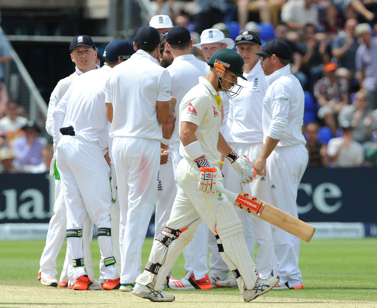 <a></a>Australia's David Warner walks back to the pavilion after being trapped LBW by England's Moeen Ali for 52 runs (Photo: AP)