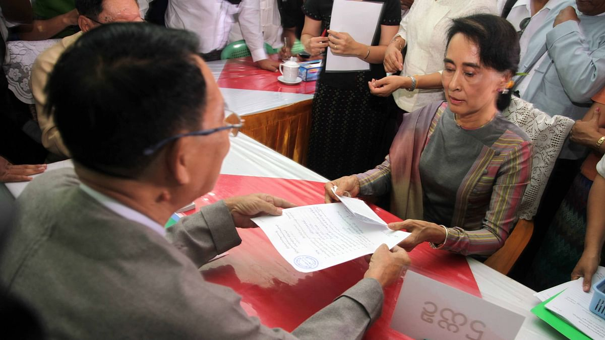 File photo of  Aung San Suu Kyi registering for November elections to keep her seat in parliament and challenge the ruling military-backed party. (Photo: AP)