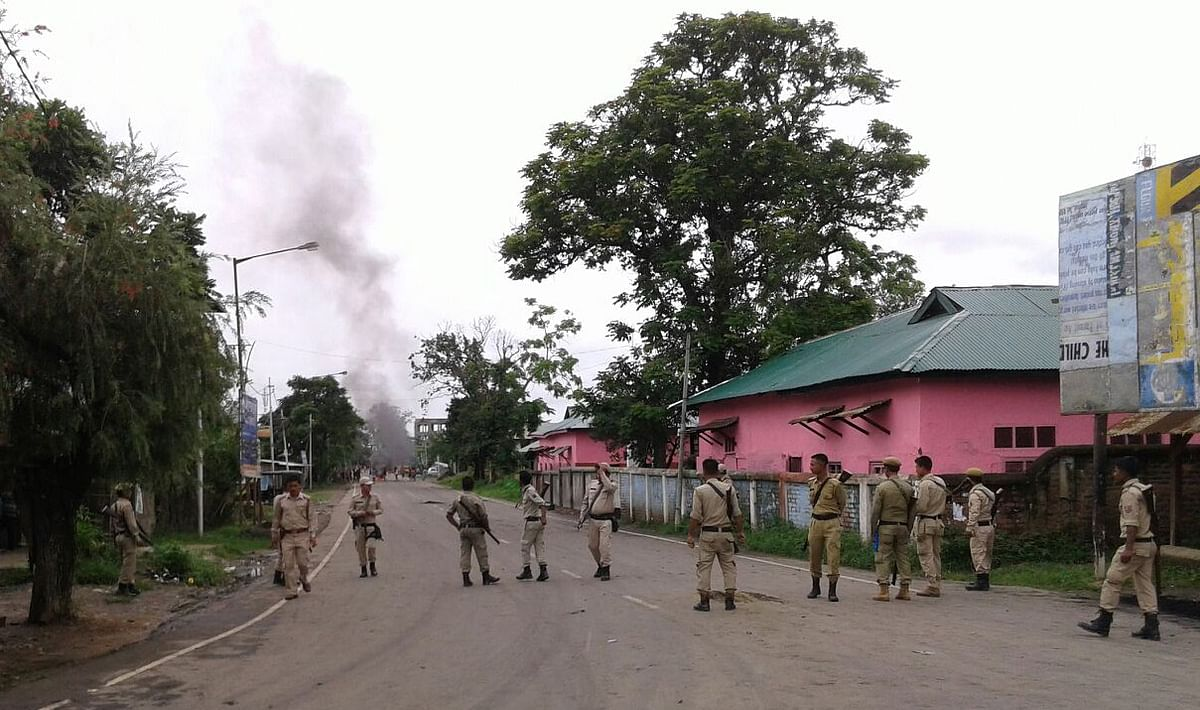 Policemen stand in Greater Imphal after a curfew was imposed in the city.(Photo: Sunzu Bachaspatimayum)