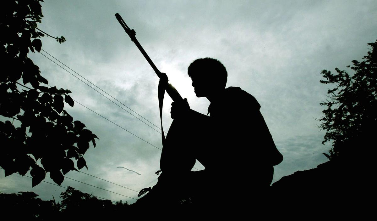 A Naga rebel stands guard (Photo: Reuters)