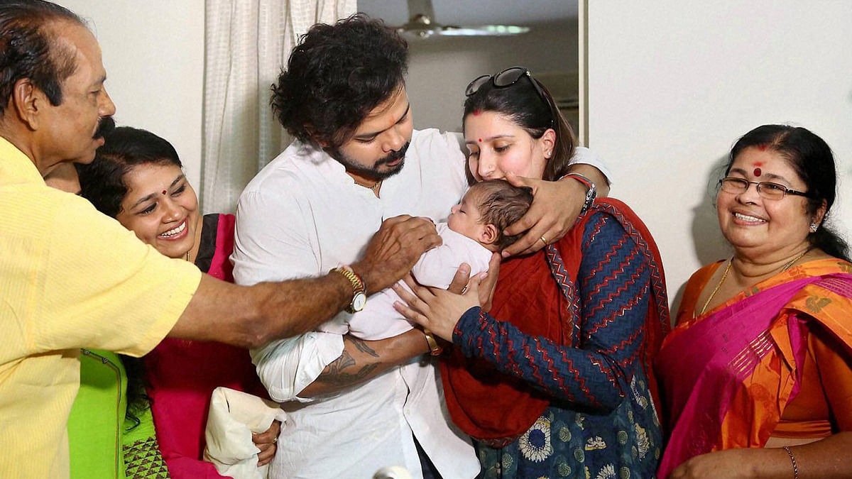 S Sreesanth celebrates with his family, after discharged by a Delhi court in IPL scam, at his residence in Kochi on Sunday. (Photo:PTI)