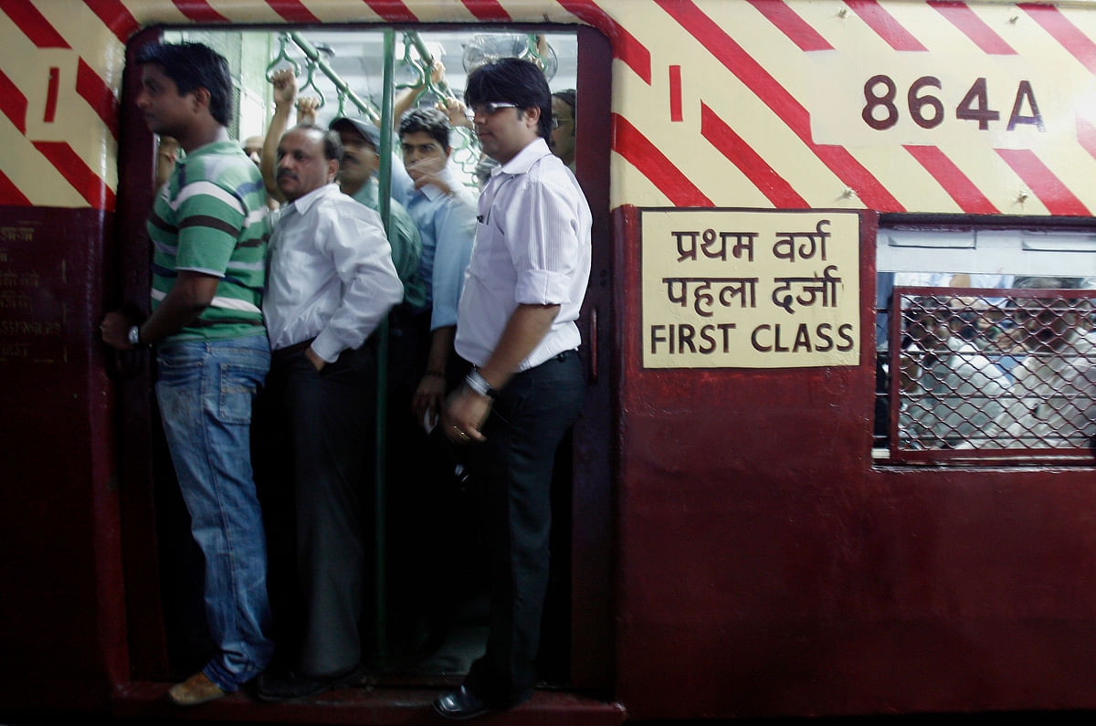 Train commuters travel in the refurbished coach that was damaged in one of the bomb blasts at Mahim station in Mumbai. (Photo: Reuters)