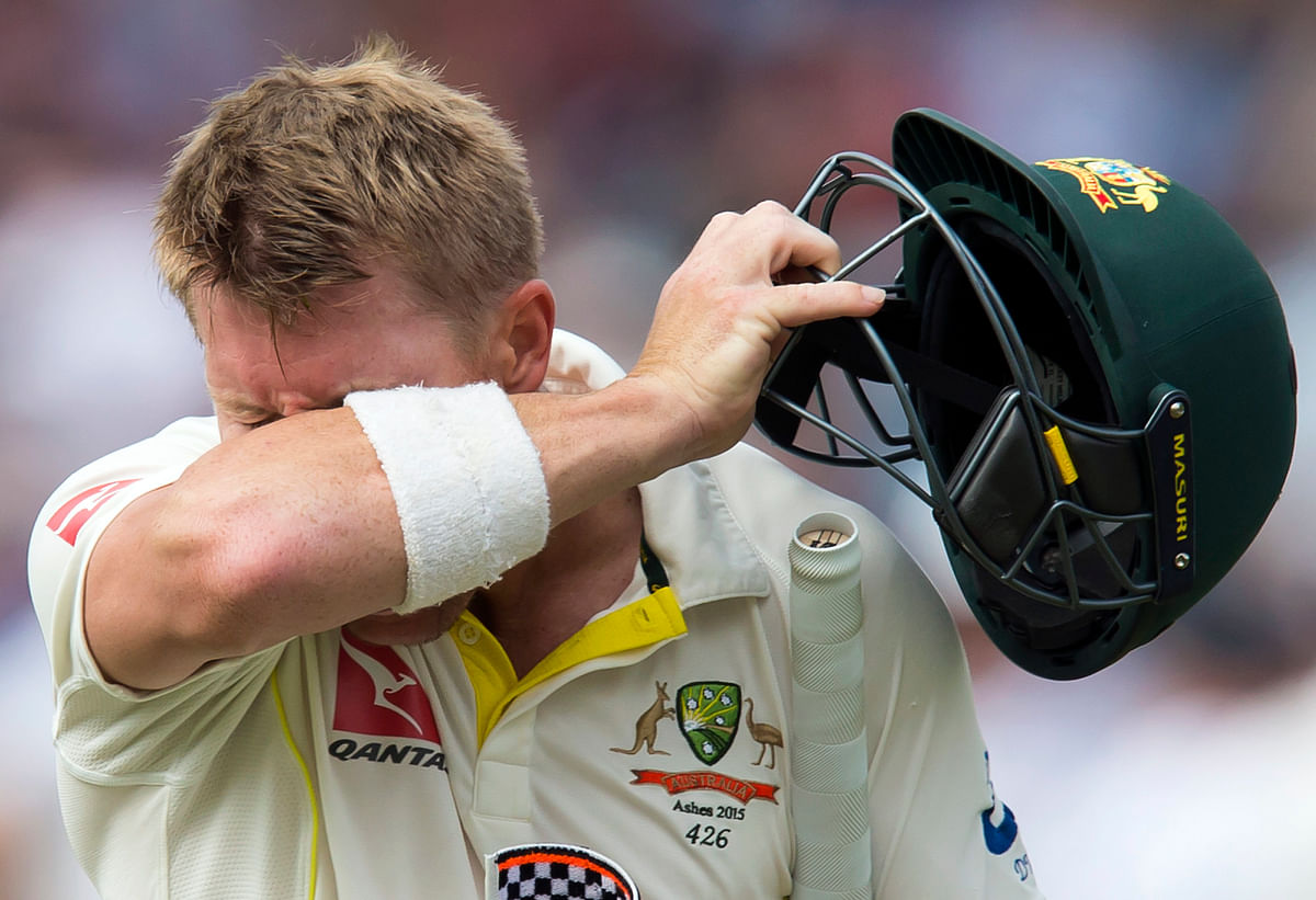 Australia's David Warner makes his way from the pitch after losing his wicket for 64, caught by England's Stuart Broad off Stokes. (Photo: AP)