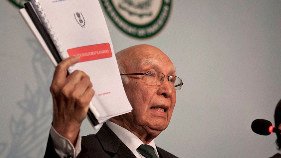 Pakistan's Advisor to the Prime Minister on Foreign Affairs, Sartaj Aziz shows dossiers about Indian intelligence agency RAW's involvement in promoting terrorism in Pakistan during a press conference in Islamabad, Pakistan. (Photo: PTI)