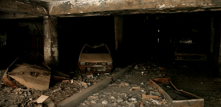 "The Uphaar Grand, after the fire had been put out (Courtesy: <a href=""https://www.youtube.com/watch?v=J-de1cyUFJo"">youtube.com/WildfilmsIndia</a>)&nbsp;"
