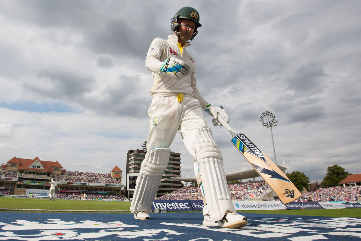 Australia's Michael Clarke makes his way back to the dressing room after losing his wicket, caught by England's Ian Bell. (Photo: AP)
