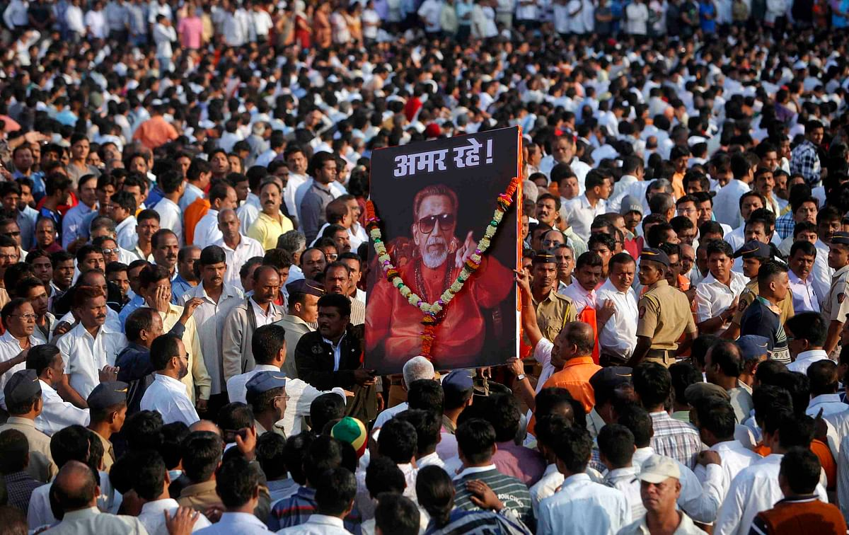 Shiv Sena supporters carry a portrait of Bal Thackeray before his funeral procession in Mumbai in November 2012 (Photo: Reuters)