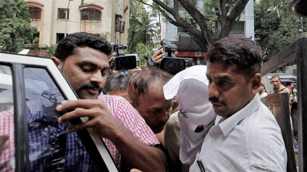 Sanjeev Khanna at Khar Police Station in Mumbai  in connection with the Sheena Bora murder case. (Photo: PTI)