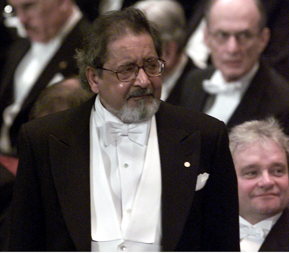 A visibly emotional VS Naipaul waits to receive his Nobel prize for literature at Stockholm's Konserthuset from Sweden's King Carl Gustaf on 10 December, 2001.