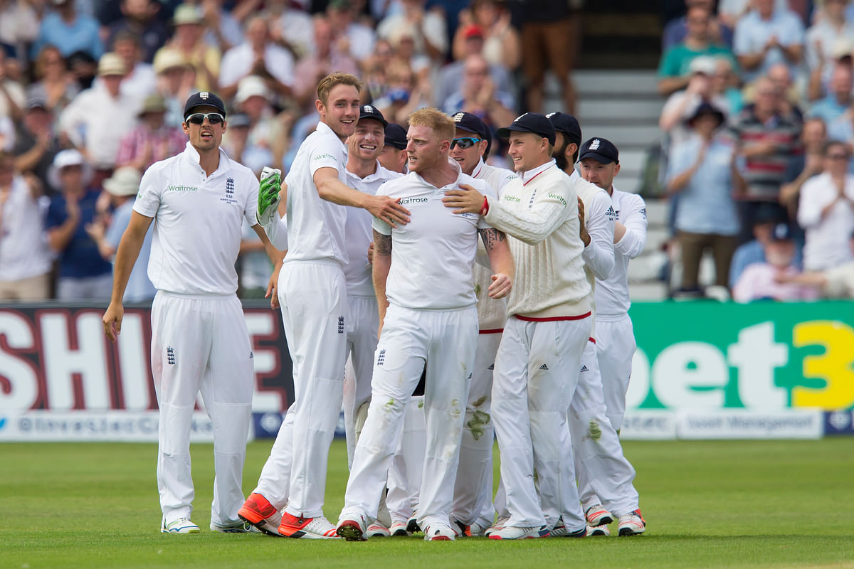 England's Stuart Broad, second left, celebrates with teammates after taking the wicket of Australia's Steven Smith, caught by Ben Stokes. (Photo: AP)