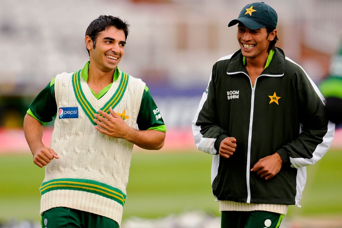 Pakistan's captain Salman Butt laughs with team-mate Mohammad Aamir (R) during a training session at Trent Bridge, Nottingham. (Photo: Reuters)