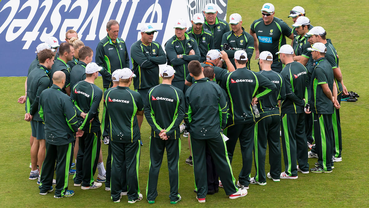 Australian players gather on the pitch before play on the second day of the fourth Ashes test cricket match between England and Australia at Trent Bridge cricket ground in Nottingham, England. (Photo: AP)