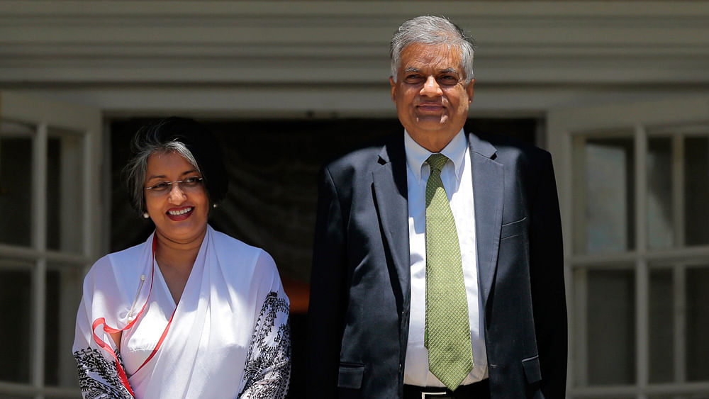 File photo of Ranil Wickremesinghe with his wife Maithree after the swearing-in as Prime Minister of Sri Lanka. (Photo: AP)
