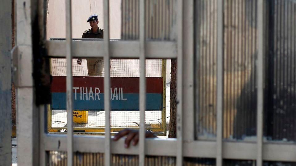 A policeman walks inside  Tihar Jail in New Delhi. (Photo: Reuters)