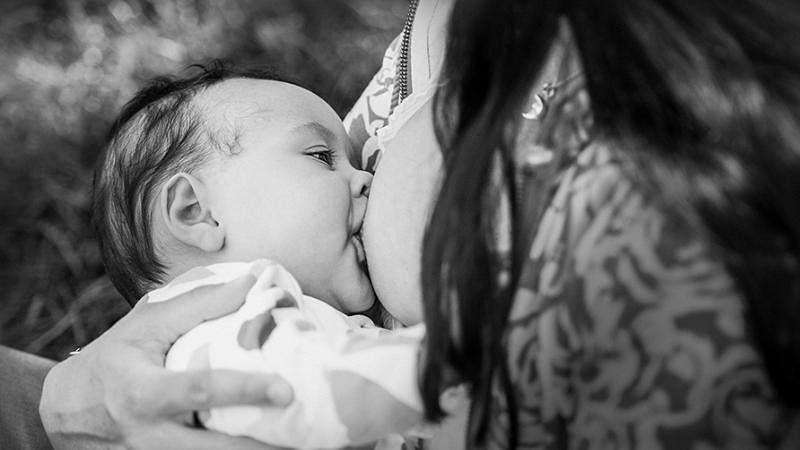 """It is NOT easy. The sore nipples, the latching issues, the teething infant; breastfeeding hurts. Three cheers for all mothers! (Photo: <a href=""""http://tammynicolephotography.com/"""">tammynicolephotography.com</a>)"""