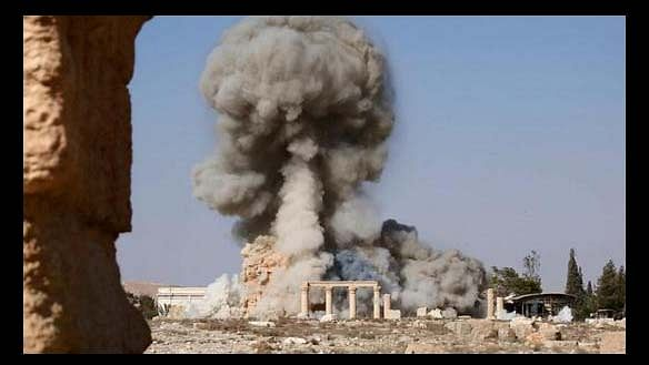 ISIS militants blowing up the Palmyra temple. (Photo: AP)