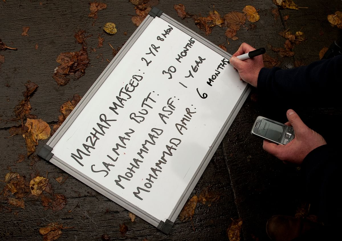 A white board  filled by a BBC producer with the various length of prison sentences  after sentencing was concluded for Pakistan cricketers Salman Butt, Mohammad Asif and Mohammad Amir and agent Mazhar Majeed in London. (Photo: Reuters)