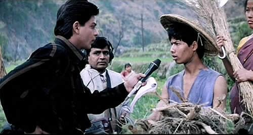 Shah Rukh Khan in a scene with tribals from Mani Ratnam's <i>Dil Se</i>