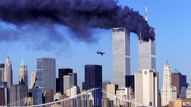 Hijacked United Airlines Flight 175 flies towards the World Trade Center, as the north tower burns following an earlier attack.