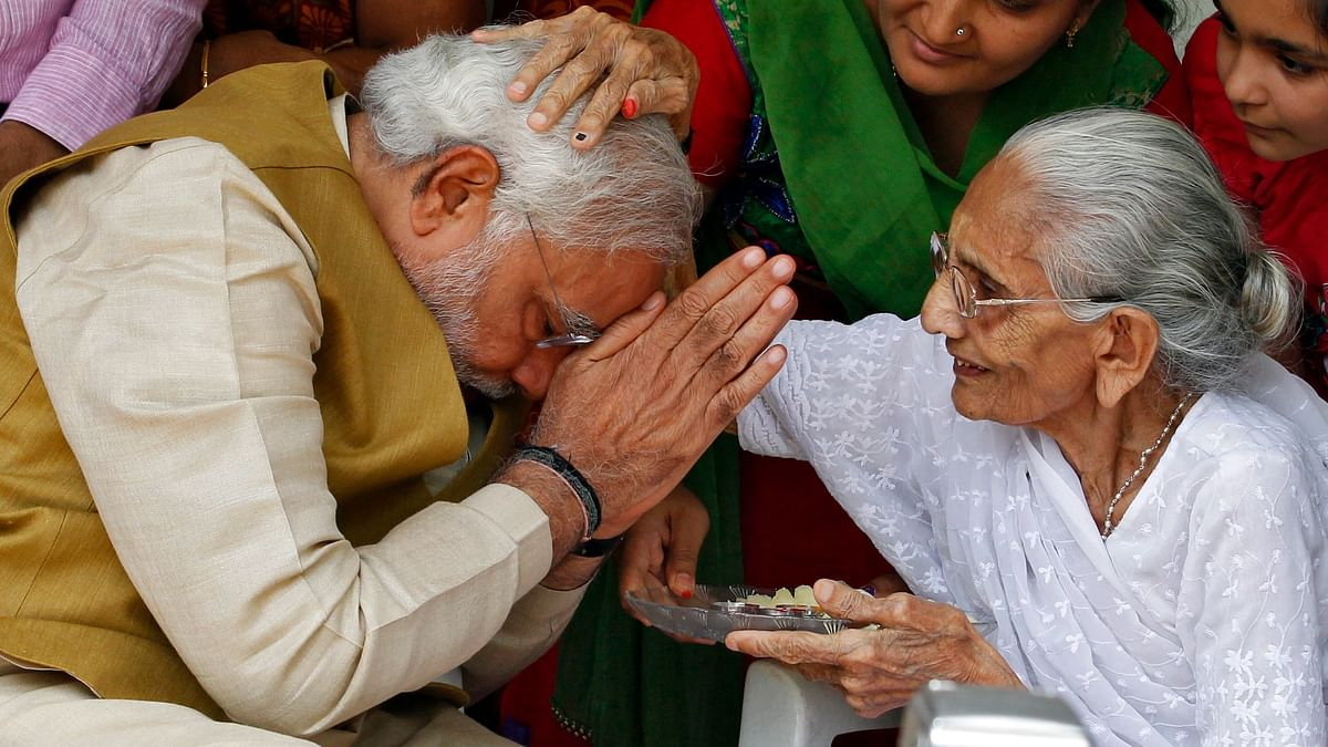 Prime MinisterNarendra Modi  seeks blessings from his mother Heeraben at her residence in Gandhinagar in the western Indian state of Gujarat May 16, 2014. (Photo: Reuters)